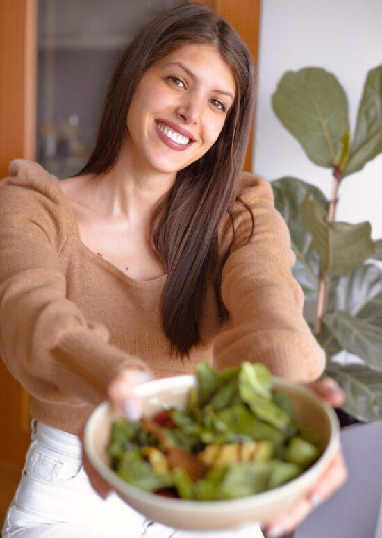 Ana Rebelo, author of zestandthecity.com with a salad bowl
